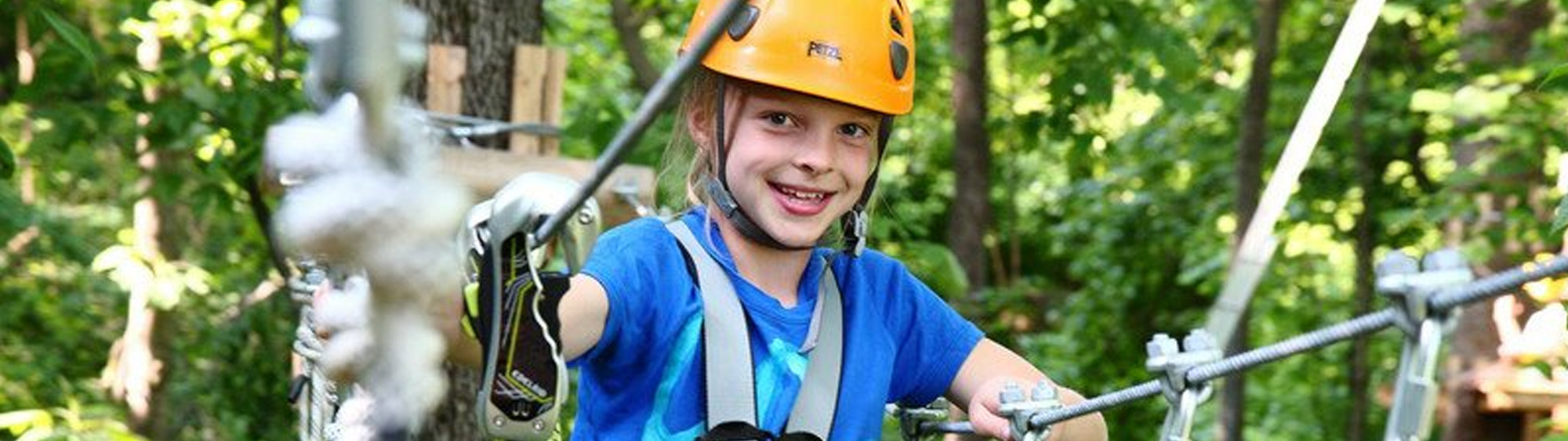 young girl on aerial adventure park in harpers ferry wv